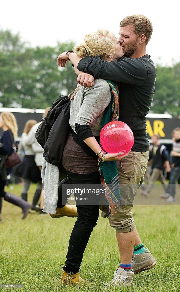 Festival goers kiss during Roskilde Festival 2012 on July 6, 2012 in Roskilde, Denmark.
