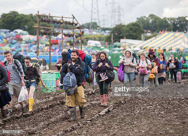 Festival goers leave the Glastonbury Festival 2016 at Worthy Farm Pilton on June 26 2016 near Glastonbury England The Festival which Michael Eavis...