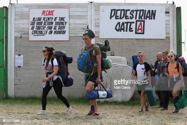 Festival goers leave the Glastonbury Festival site at Worthy Farm in Pilton on June 26 2017 near Glastonbury England Glastonbury Festival of...