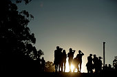 Festival goers look on at sunset during Splendour in the Grass 2016 on July 22 2016 in Byron Bay Australia