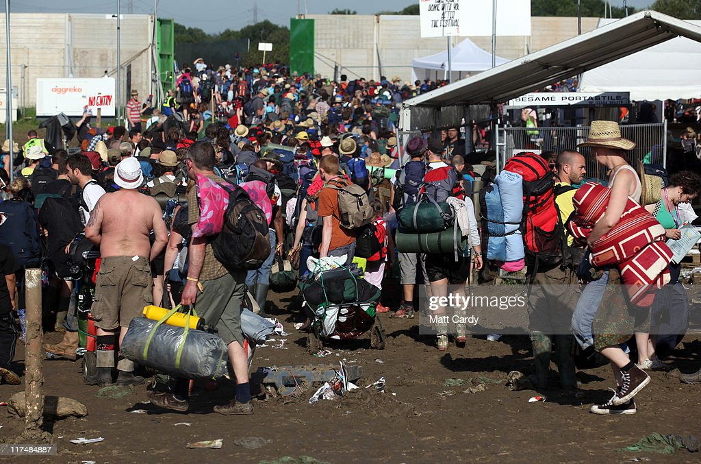 Festival goers make their way to the exits and the coach and bus station beyond as they begin to leave the Glastonbury Festival site on June 27, 2011 at Worthy Farm, Pilton. As the 140,000 plus music fans began to leave this morning the clean up of the 1000s of tonnes of rubbish left by them begins. The festival, which started in 1970 when several hundred hippies paid 1 GBP to watch Marc Bolan, has grown into Europe's largest music festival attracting more than 175,000 people over five days.