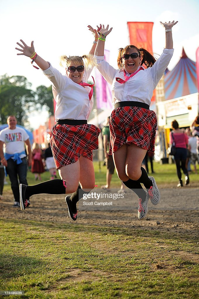 Festival goers Marion Lewis (L) and Louise Murray (R) from Dundee pose in fancy dress during Rewind 80s Festival 2013 at Scone Palace on July 26, 2013 in Perth, Scotland.