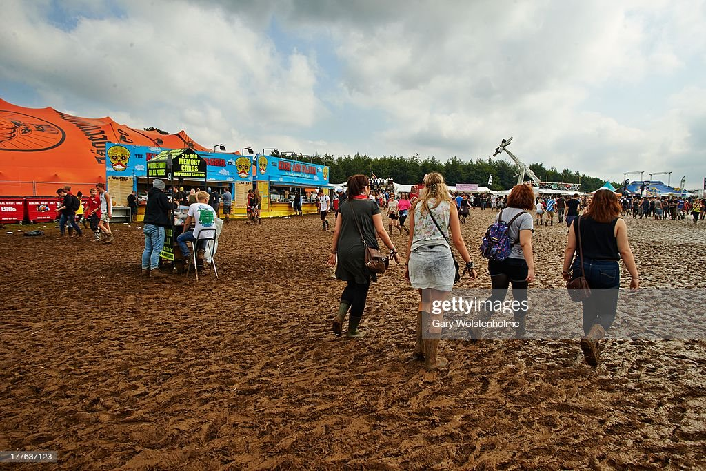 Festival goers negotiate the mud after heavy rain during Day 3 of Leeds Festival 2013 at Bramham Park on August 25, 2013 in Leeds, England.