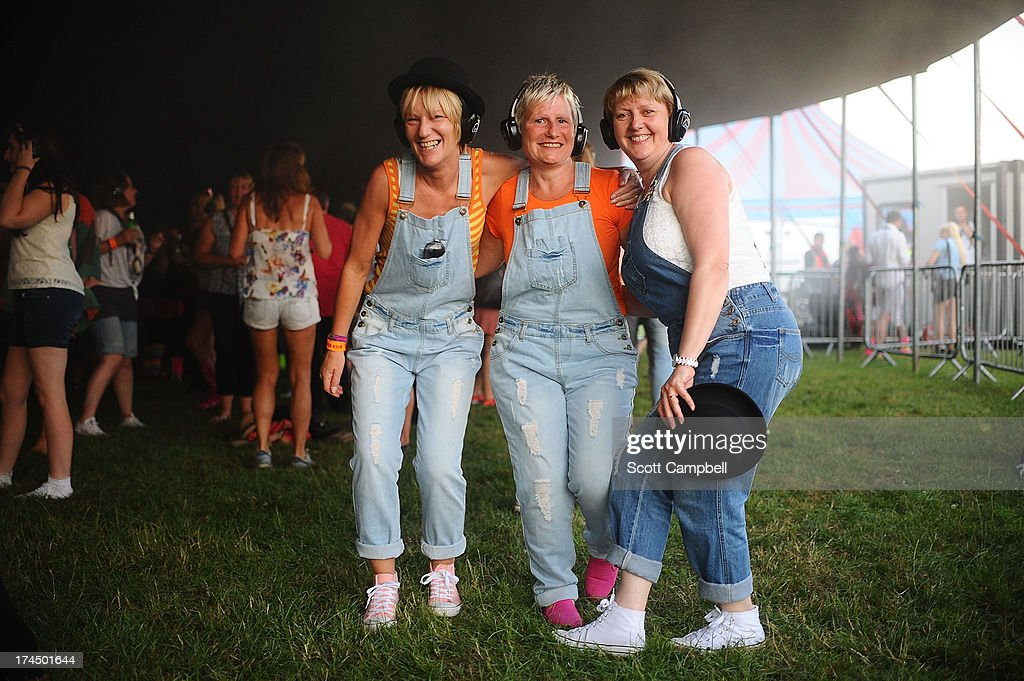 Festival goers participate in the Silent Disco during Rewind 80s Festival 2013 at Scone Palace on July 26, 2013 in Perth, Scotland.