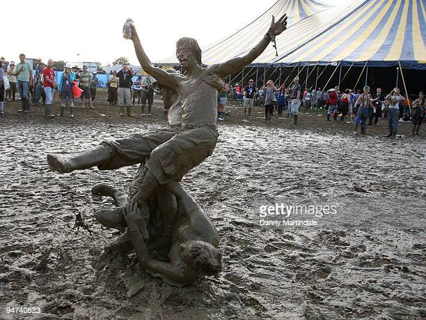 Festival goers play in the mud on day two of the Glastonbury Festival at Worthy Farm on June 26 2009 in Glastonbury England