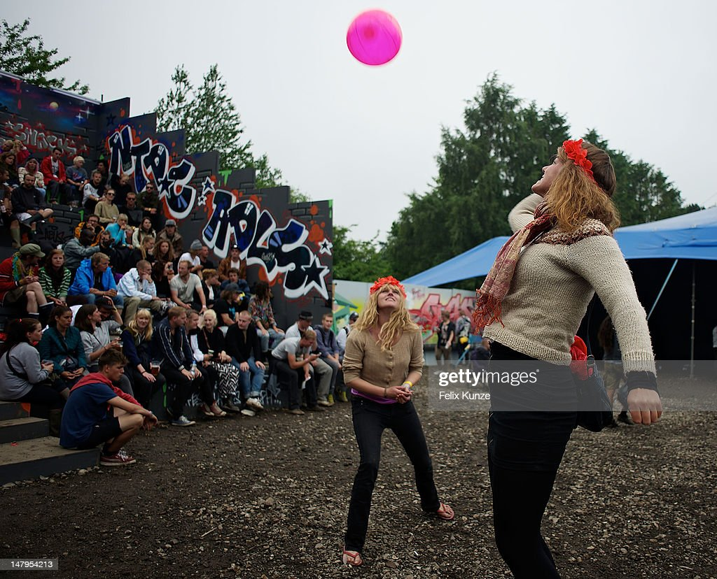 Festival goers play with an inflatable during Roskilde Festival 2012 on July 6, 2012 in Roskilde, Denmark.