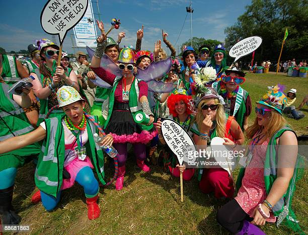 Festival Goers posing as the Green Police prevent litter and unauthorised urinary infractions on the first day of Glastonbury Festival at Worthy Farm...