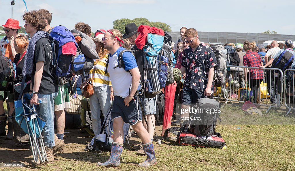 Festival goers queue for buses as they leave the Glastonbury Festival 2016 at Worthy Farm, Pilton on June 26, 2016 near Glastonbury, England. The Festival, which Michael Eavis started in 1970 when several hundred hippies paid just £1, now attracts more than 175,000 people.