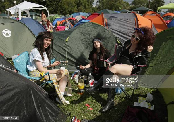 Festival goers relaxing by their tents at the Reading Festival at Little John's Farm on Richfield Avenue Reading