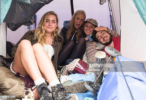 Festival goers shelter from the rain in their tent at the Glastonbury Festival at Worthy Farm Pilton on June 28 2015 in Glastonbury England Now its...
