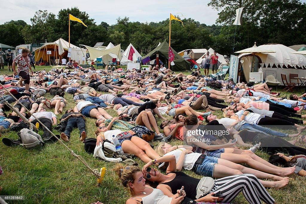 Festival goers take part in a 'Yoga Laughter' session in the Green Fields, as revellers gather ahead of this weekends Glastonbury Festival of Music and Performing Arts on Worthy Farm near Pilton in Somerset, south west England, on June 26, 2014.