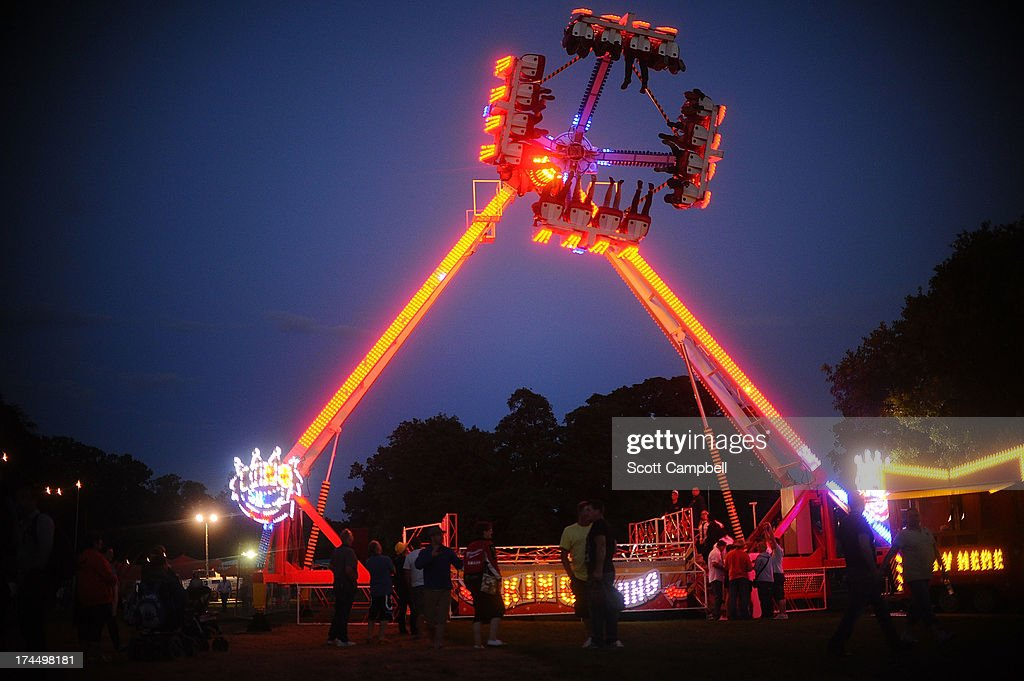 Festival goers use a ride during Rewind 80s Festival 2013 at Scone Palace on July 26, 2013 in Perth, Scotland.