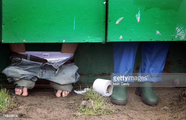 Festival goers use the toilets at Worthy Farm Pilton near Glastonbury on June 21 2007 in Somerset England The festival that was started by dairy...