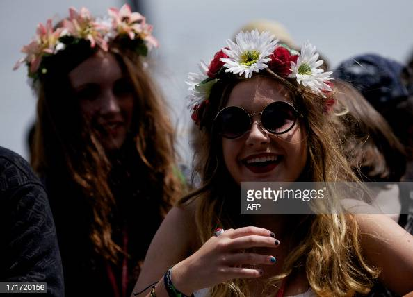 Festival goers wait at the Pyramid stage on the third day of the Glastonbury Festival of Contemporary Performing Arts near Glastonbury southwest...