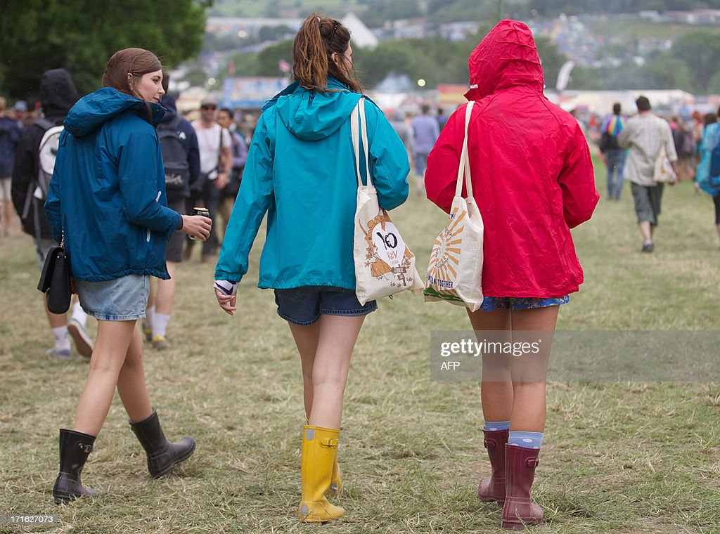 Festival goers walk around the site on the second day of the Glastonbury Festival of Contemporary Performing Arts near Glastonbury, southwest England on June 27, 2013. The festival attracts 170,000 party-goers to the dairy farm in Somerset, and this year's tickets sold out within two hours of going on sale. The Rolling Stones will perform at the festival for the first time, headlining on Saturday night. AFP PHOTO/ANDREW COWIE