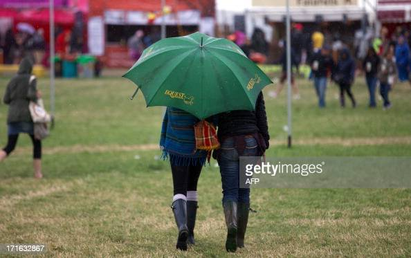 Festival goers walk around the site on the second day of the Glastonbury Festival of Contemporary Performing Arts near Glastonbury southwest England...