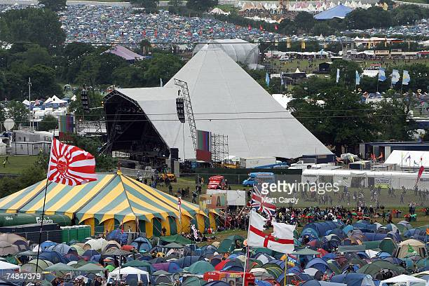 Festival goers walk in front of the Pyramid Stage at Worthy Farm Pilton near Glastonbury on June 21 2007 in Somerset England The festival that was...