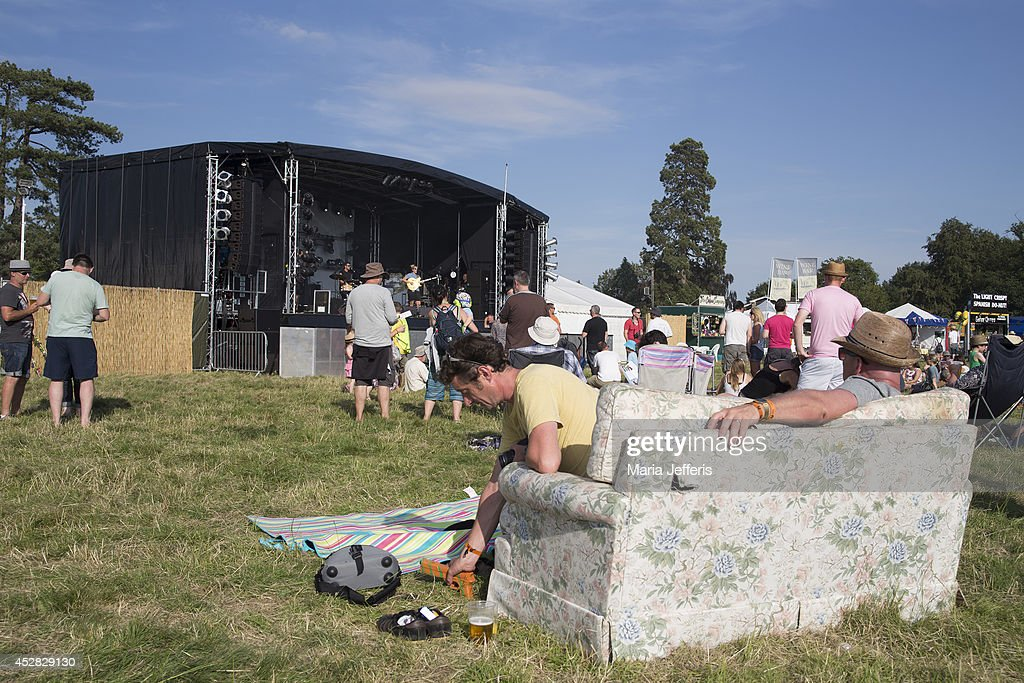 Festival goers watch bands from a sofa at Deer Shed Festival at Baldersbey Park, Topcliffe on July 25, 2014 in Thirsk, United Kingdom.