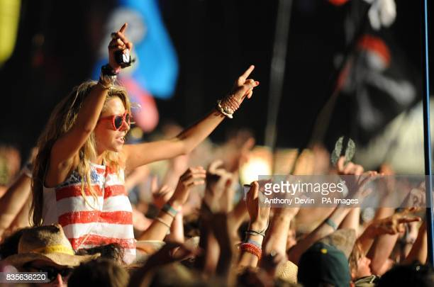 Festival goers watch Bruce Springsteen and the E Street band performing during the 2009 Glastonbury Festival at Worthy Farm in Pilton Somerset