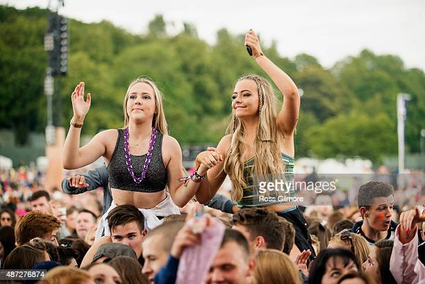 Festival goers watch Calvin Harris perform at Bellahouston Park on August 30 2015 in Glasgow Scotland