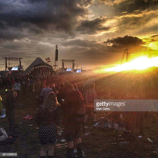 Festival goers watch elbow on the main Pyramid Stage at the 2014 Glastonbury Festival at Worthy Farm on June 27 2014 in Glastonbury England