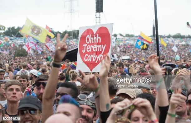 Festival goers watch Jeremy Corbyn on day 3 of the Glastonbury Festival 2017 at Worthy Farm Pilton on June 24 2017 in Glastonbury England