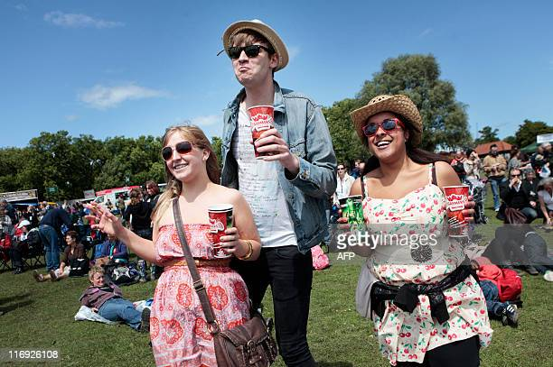 Festival goers watch The Undertones in the sunshine at Feis Festival in Finsbury Park in London on June 18 2011 AFP PHOTO/ OLIVIA HARRIS