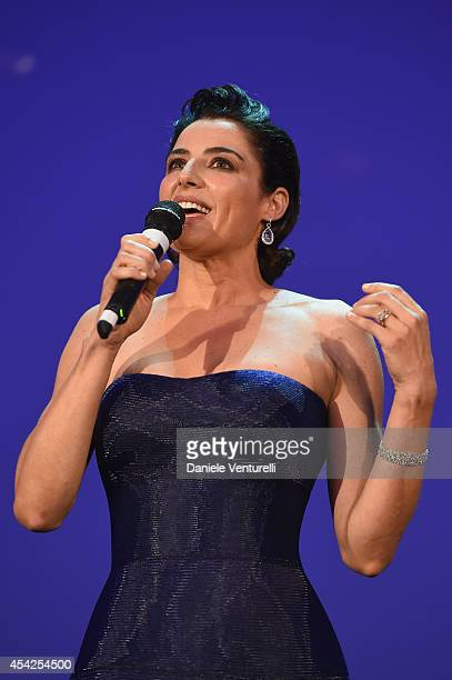 Festival hostess and actress Luisa Ranieri speaks at the Opening Ceremony during the 71st Venice Film Festival at Palazzo Del Cinema on August 27...