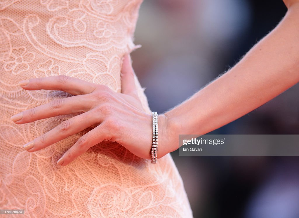 Festival hostess <a gi-track='captionPersonalityLinkClicked' href=/galleries/search?phrase=Eva+Riccobono&family=editorial&specificpeople=885062 ng-click='$event.stopPropagation()'>Eva Riccobono</a> (detail) wears a Jaeger-LeCoultre Vintage Couvercle watch during the Opening Ceremony and 'Gravity' Premiere during the 70th Venice Film Festival at the Palazzo del Cinema on August 28, 2013 in Venice, Italy.