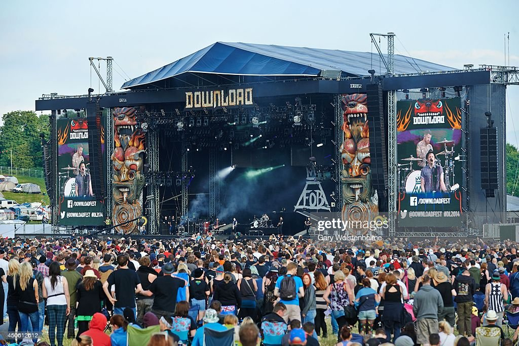 festival oers enjoy the atmosphere at the main stage during day 2 of Download Festival at Donnington Park on June 14, 2014 in Donnington, United Kingdom.