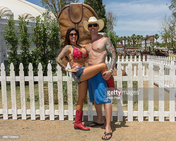 Festival patrons pose during day 1 of 2014 Stagecoach California's Country Music Festival at the Empire Polo Club on April 25 2014 in Indio California