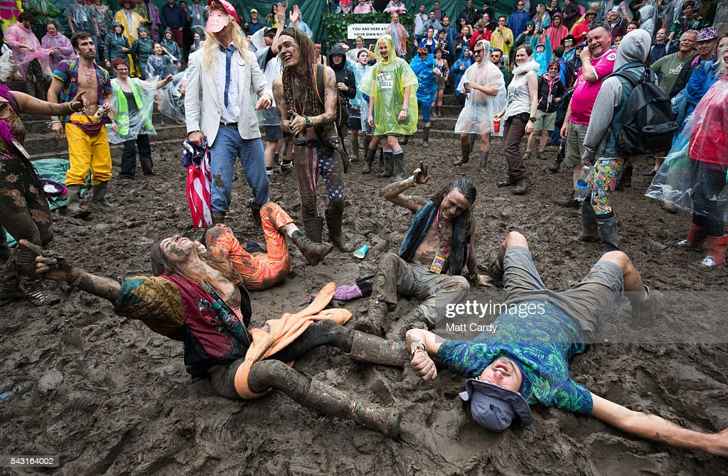 Festival revellers prepare to take part in a tomato fight at the Glastonbury Festival 2016 at Worthy Farm, Pilton on June 25, 2016 near Glastonbury, England. The Festival, which Michael Eavis started in 1970 when several hundred hippies paid just £1, now attracts more than 175,000 people.