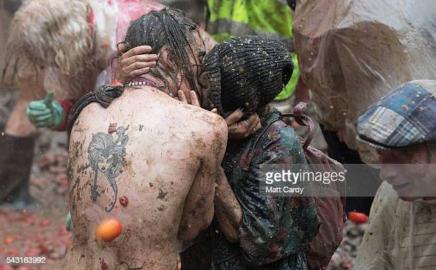 Festival revellers take part in a tomato fight at the Glastonbury Festival 2016 at Worthy Farm Pilton on June 25 2016 near Glastonbury England The...