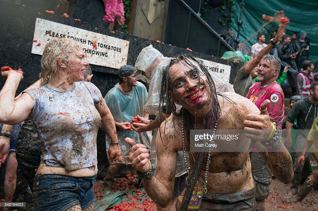 Festival revellers take part in a tomato fight at the Glastonbury Festival 2016 at Worthy Farm, Pilton on June 25, 2016 near Glastonbury, England. The Festival, which Michael Eavis started in 1970 when several hundred hippies paid just £1, now attracts more than 175,000 people.