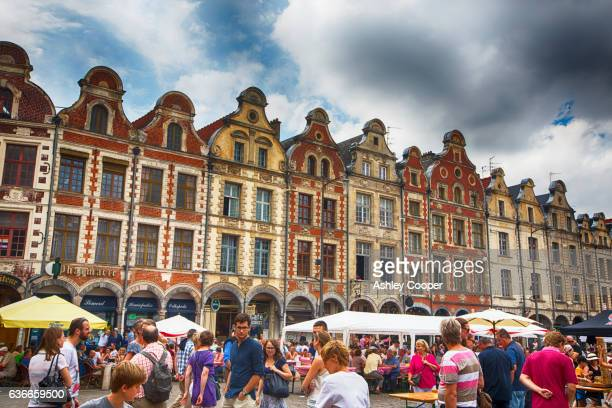 A festival taking place in the town square opposite the cathedral in Arras, Northern France