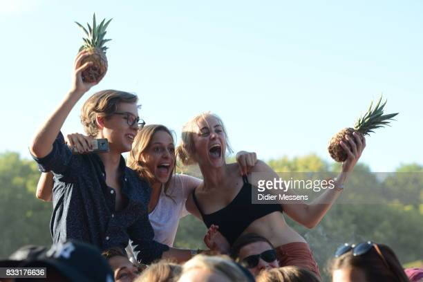 Festival visitors are seen with pineapples during the concert of Glass Animals on August 14 2017 in Budapest Hungary