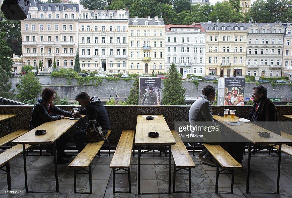 Festival visitors relax during the 48th Karlovy Vary International Film Festival (KVIFF) on June 29, 2013 in Karlovy Vary, Czech Republic.