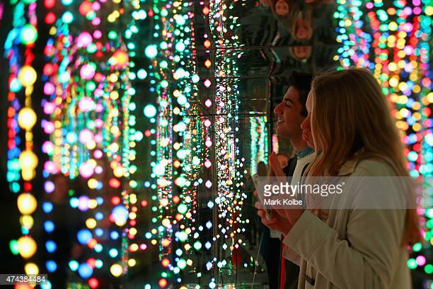 Festival visitors stop to photograph themselves as they walk through the 'Internal Galaxy' installation as part of the Vivid Sydney Festival on May...