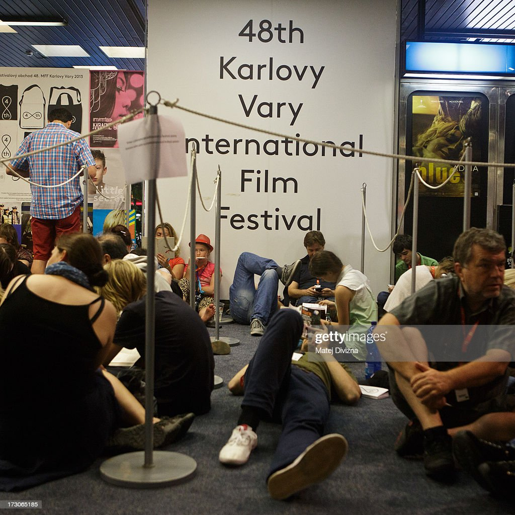 Festival visitors wait for screening during the 48th Karlovy Vary International Film Festival (KVIFF) on July 05, 2013 in Karlovy Vary, Czech Republic.