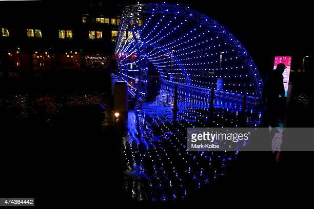 Festival visitors walk through the 'Harbour Wave' installation seen illuminated across a wharf at Walsh Bay as part of the Vivid Sydney Festival on...