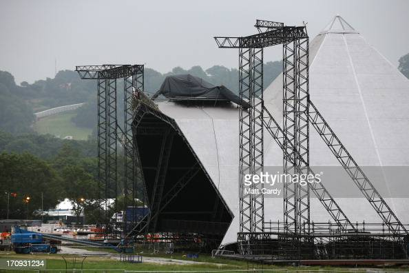 Festival workers work on the Pyramid Stage at the Glastonbury Festival of Contemporary Performing Arts site at Worthy Farm in Pilton on June 20 2013...