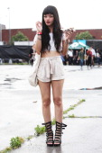 A festivalgoer attends during the 2011 Northside Music Festival at McCarren Park on June 17 2011 in the Brooklyn borough of New York City