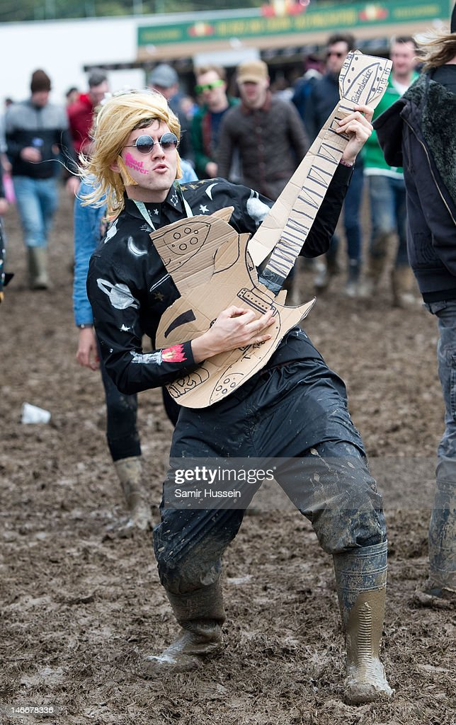 A festival-goer braves the mud on day 2 of The Isle of Wight Festival at Seaclose Park on June 22, 2012 in Newport, Isle of Wight.