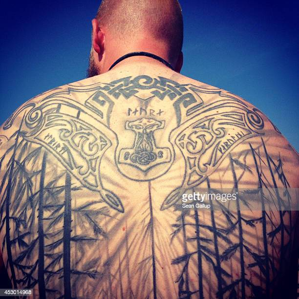 A festivalgoer from Denmark shows his tattoo while attending the 2014 Wacken Open Air heavy metal music festival on on July 31 2014 in Wacken Germany...