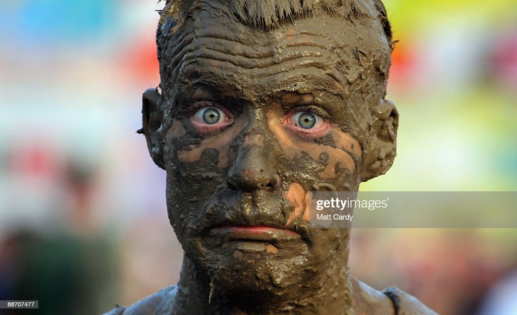 A festival-goer gets covered in mud near the main Pyramid Stage at the Glastonbury Festival on June 26, 2009 in Glastonbury, England. Heavy rain and thunderstorms have greeted the 137,000 music fans who are expected on site for what has become one of Europe's largest festivals.
