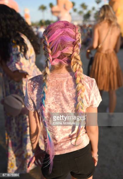 Festivalgoer pink purple and blue hair braid detail attends day 2 of the 2017 Coachella Valley Music Arts Festival at the Empire Polo Club on April...