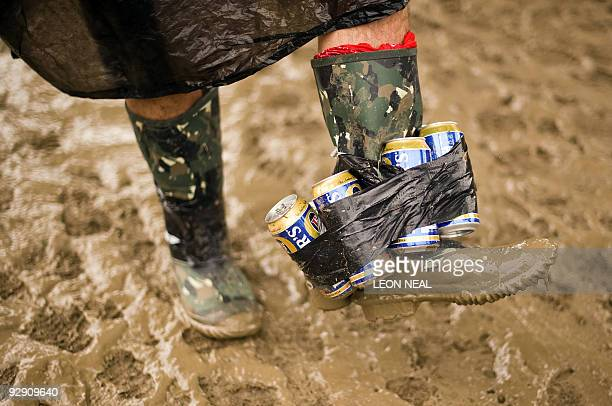 A festivalgoer shows of his unusual way of carrying his beer supplies on the first 'official' day of the annual Glastonbury festival near Glastonbury...