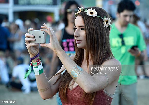 A festivalgoer takes a photo during day 2 of the 2015 Coachella Valley Music And Arts Festival at The Empire Polo Club on April 18 2015 in Indio...