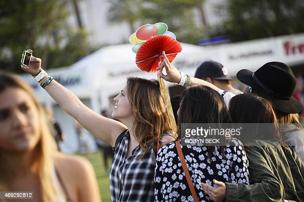 A festivalgoer takes a 'Selfie' without the aid of a 'Selfie stick' on the first day of the Coachella Music Festival in Indio California April 10...