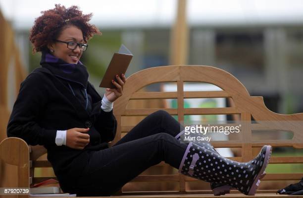 A festivalgoer uses the Reader from Sony during the Guardian Hay Festival on May 22 2009 in HayonWye England Sony a new sponsor of the Guardian Hay...
